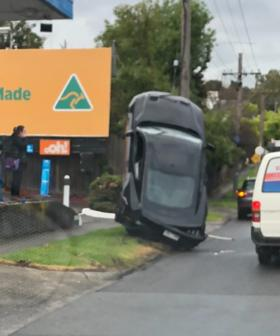 Mustang On Its Side In Kew After Crazy Pole Collision